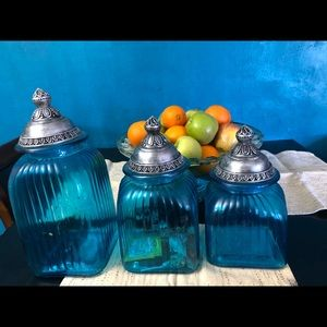 Blue jugs serve for storage and/or hole decoration